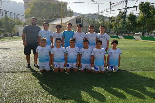 REAL MADRID WITH PARADIS D'ENFANTS FOOTBALL TEAM
